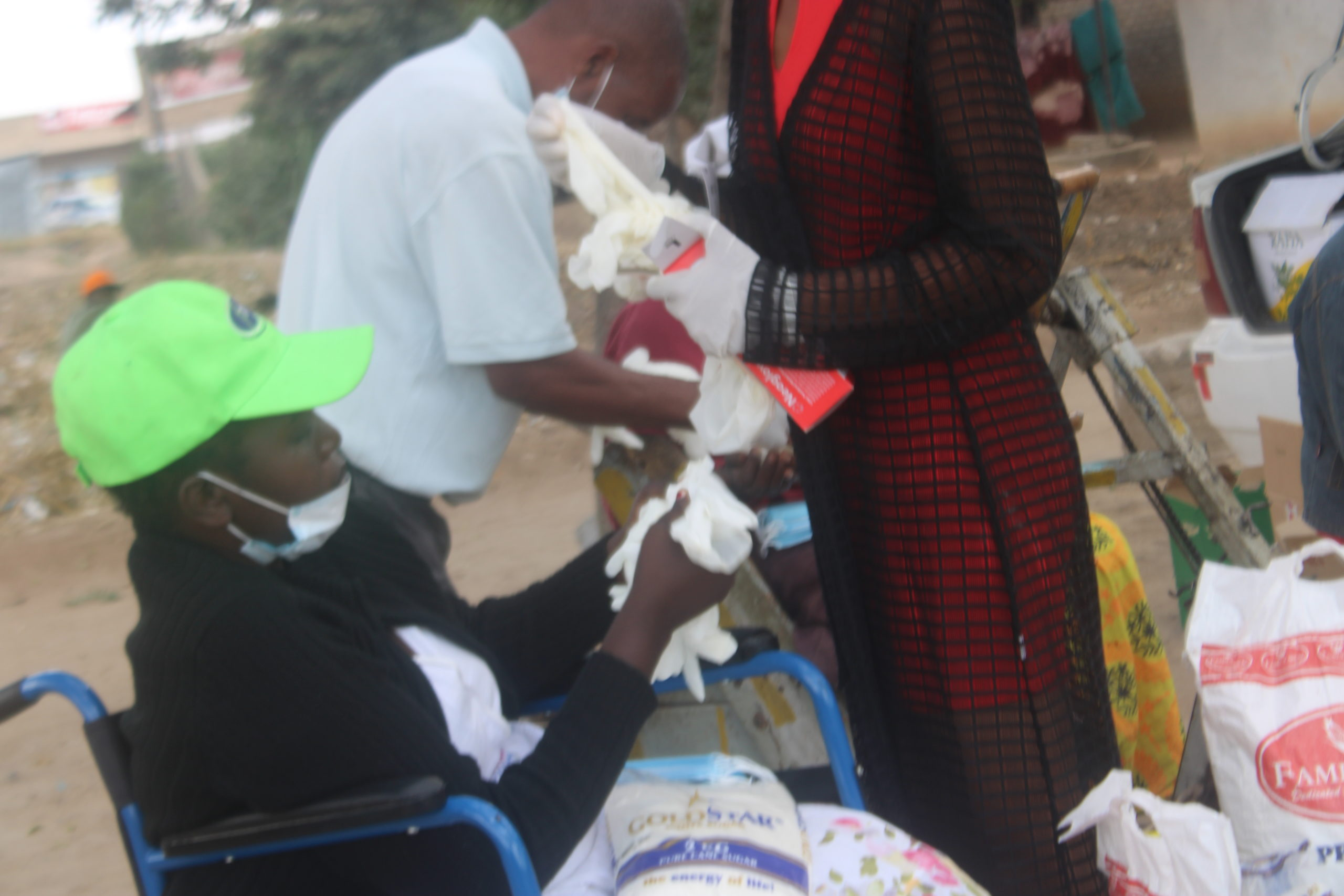 Photo of Businesswoman Maureen Mbondiah donates to women with disabilities